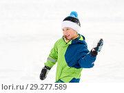 Купить «happy boy playing and throwing snowball in winter», фото № 29277589, снято 10 февраля 2018 г. (c) Syda Productions / Фотобанк Лори