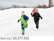 Купить «happy little kids playing outdoors in winter», фото № 29277593, снято 10 февраля 2018 г. (c) Syda Productions / Фотобанк Лори