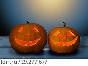 Купить «close up of halloween pumpkins on table», фото № 29277677, снято 17 сентября 2014 г. (c) Syda Productions / Фотобанк Лори