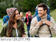 Купить «happy friends or travelers with backpacks hiking», фото № 29277745, снято 31 августа 2014 г. (c) Syda Productions / Фотобанк Лори