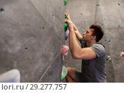 Купить «young man exercising at indoor climbing gym», фото № 29277757, снято 2 марта 2017 г. (c) Syda Productions / Фотобанк Лори