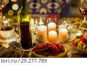 Купить «food, drinks and candles burning on table», фото № 29277789, снято 17 декабря 2017 г. (c) Syda Productions / Фотобанк Лори
