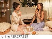 Купить «happy female friends eating waffles at home», фото № 29277829, снято 21 января 2018 г. (c) Syda Productions / Фотобанк Лори