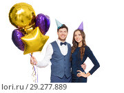 Купить «happy couple with party caps and balloons», фото № 29277889, снято 3 марта 2018 г. (c) Syda Productions / Фотобанк Лори