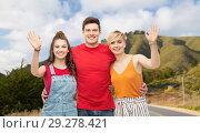 Купить «happy friends hugging over big sur hills and road», фото № 29278421, снято 30 июня 2018 г. (c) Syda Productions / Фотобанк Лори