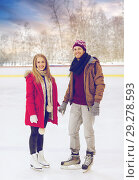 Купить «happy couple holding hands on outdoor skating rink», фото № 29278593, снято 26 ноября 2014 г. (c) Syda Productions / Фотобанк Лори