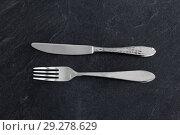 Купить «close up of fork and knife on table», фото № 29278629, снято 4 апреля 2018 г. (c) Syda Productions / Фотобанк Лори