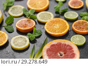 Купить «close up of grapefruit, orange, pomelo and lime», фото № 29278649, снято 4 апреля 2018 г. (c) Syda Productions / Фотобанк Лори
