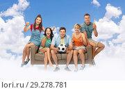 Купить «friends or soccer fans with ball and drinks in sky», фото № 29278781, снято 30 июня 2018 г. (c) Syda Productions / Фотобанк Лори
