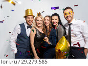 Купить «friends with party props and confetti laughing», фото № 29279585, снято 3 марта 2018 г. (c) Syda Productions / Фотобанк Лори