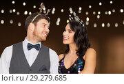 Купить «couple with christmas or new year party props», фото № 29279685, снято 15 декабря 2017 г. (c) Syda Productions / Фотобанк Лори