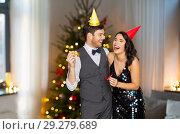 Купить «couple with party blowers having fun on christmas», фото № 29279689, снято 15 декабря 2017 г. (c) Syda Productions / Фотобанк Лори