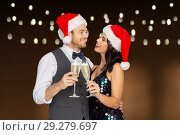 Купить «couple with champagne glasses at christmas party», фото № 29279697, снято 15 декабря 2017 г. (c) Syda Productions / Фотобанк Лори
