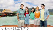 Купить «friends in sunglasses over bora bora background», фото № 29279713, снято 30 июня 2018 г. (c) Syda Productions / Фотобанк Лори