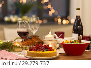 Купить «food and drinks on christmas table at home», фото № 29279737, снято 17 декабря 2017 г. (c) Syda Productions / Фотобанк Лори