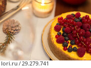 Купить «close up of berry cake on christmas table at home», фото № 29279741, снято 17 декабря 2017 г. (c) Syda Productions / Фотобанк Лори