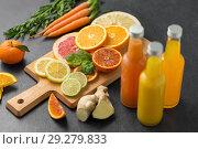 Купить «glass bottles of fruit juice on slate table top», фото № 29279833, снято 4 апреля 2018 г. (c) Syda Productions / Фотобанк Лори