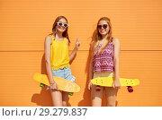 Купить «teenage girls with short skateboards outdoors», фото № 29279837, снято 19 июля 2018 г. (c) Syda Productions / Фотобанк Лори