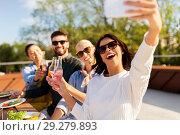 Купить «happy friends taking selfie at rooftop party», фото № 29279893, снято 2 сентября 2018 г. (c) Syda Productions / Фотобанк Лори