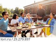 Купить «friends at barbecue party on rooftop in summer», фото № 29279897, снято 2 сентября 2018 г. (c) Syda Productions / Фотобанк Лори