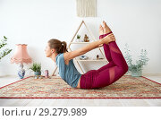 Купить «young woman doing bow pose at yoga studio», фото № 29279989, снято 21 июня 2018 г. (c) Syda Productions / Фотобанк Лори