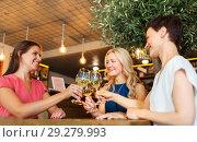 Купить «happy women drinking wine at bar or restaurant», фото № 29279993, снято 25 июня 2018 г. (c) Syda Productions / Фотобанк Лори