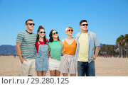 Купить «happy friends in sunglasses over venice beach», фото № 29280125, снято 30 июня 2018 г. (c) Syda Productions / Фотобанк Лори