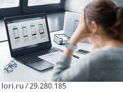 Купить «stressed designer with user interface on laptop», фото № 29280185, снято 17 января 2018 г. (c) Syda Productions / Фотобанк Лори