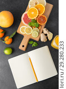 Купить «close up of fruits and notebook on slate table top», фото № 29280233, снято 4 апреля 2018 г. (c) Syda Productions / Фотобанк Лори