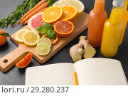 Купить «close up of fruits, juices and notebook on table», фото № 29280237, снято 4 апреля 2018 г. (c) Syda Productions / Фотобанк Лори