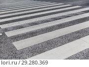 Купить «close up of crosswalk road surface marking», фото № 29280369, снято 10 февраля 2018 г. (c) Syda Productions / Фотобанк Лори