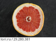 Купить «close up of fresh juicy grapefruit», фото № 29280381, снято 4 апреля 2018 г. (c) Syda Productions / Фотобанк Лори