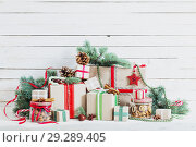 Christmas gifts on wooden background. Стоковое фото, фотограф Майя Крученкова / Фотобанк Лори