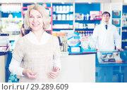 Woman near counter in pharmacy. Стоковое фото, фотограф Яков Филимонов / Фотобанк Лори