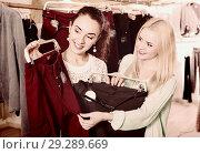 Купить «Happy young positive female friends choosing trousers», фото № 29289669, снято 19 января 2019 г. (c) Яков Филимонов / Фотобанк Лори