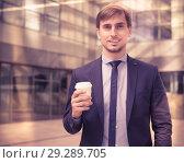 Купить «Portrait of cheerful male standing outdoor», фото № 29289705, снято 29 апреля 2017 г. (c) Яков Филимонов / Фотобанк Лори