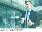 Купить «Portrait of cheerful male standing outdoor», фото № 29289729, снято 29 апреля 2017 г. (c) Яков Филимонов / Фотобанк Лори