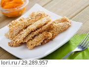 Купить «Sesame crusted chicken fingers with sauce», фото № 29289957, снято 8 апреля 2020 г. (c) Яков Филимонов / Фотобанк Лори