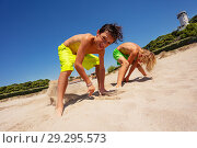 Купить «Two happy boys having fun on sandy beach in summer», фото № 29295573, снято 23 июля 2018 г. (c) Сергей Новиков / Фотобанк Лори