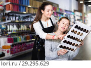 Купить «Young female hairdresser with woman client looking samples of hair dye in beauty salon», фото № 29295629, снято 31 марта 2018 г. (c) Яков Филимонов / Фотобанк Лори