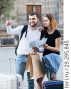 Купить «Couple of happy tourists with map and baggage», фото № 29295845, снято 25 мая 2017 г. (c) Яков Филимонов / Фотобанк Лори