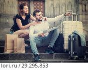 Купить «man and woman sitting the historic center with map and baggage», фото № 29295853, снято 25 мая 2017 г. (c) Яков Филимонов / Фотобанк Лори
