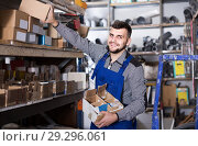 Купить «worker checking small details for sanitary engineering in workshop», фото № 29296061, снято 15 марта 2017 г. (c) Яков Филимонов / Фотобанк Лори