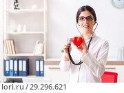 Купить «Young doctor in heart care concept», фото № 29296621, снято 5 июля 2018 г. (c) Elnur / Фотобанк Лори