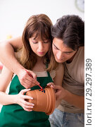 Купить «Couple decorating pots in workshop during class», фото № 29297389, снято 11 июля 2018 г. (c) Elnur / Фотобанк Лори