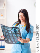 Купить «Young beautiful female doctor working in the clinic», фото № 29297597, снято 12 июля 2018 г. (c) Elnur / Фотобанк Лори