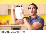 Купить «Young man blogging about food supplements», фото № 29298149, снято 19 июня 2018 г. (c) Elnur / Фотобанк Лори