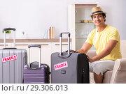 Купить «Man going on vacation with fragile suitcases», фото № 29306013, снято 4 июля 2018 г. (c) Elnur / Фотобанк Лори