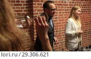 Купить «Сомелье предлагает попробовать вино. Дегустация вина», видеоролик № 29306621, снято 18 июля 2019 г. (c) Евгений Ткачёв / Фотобанк Лори