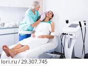 Young woman getting facial injection. Стоковое фото, фотограф Яков Филимонов / Фотобанк Лори